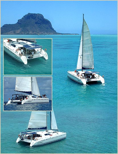 the madiana 2 luxury catamran cruising  along the mauritian coastline